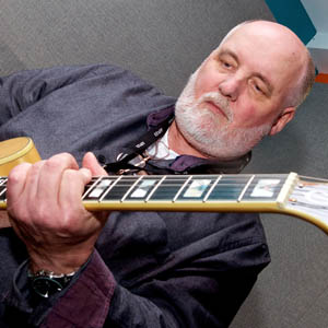 Picture of Steve Thompson with a guitar